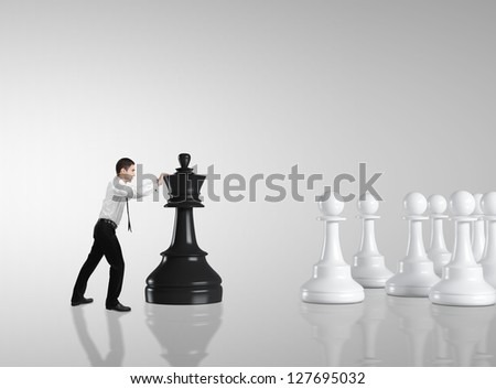 businessman moving chess  on gray background