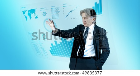 Businessman navigating interface in future (outstanding business people in interiors / interfaces series)