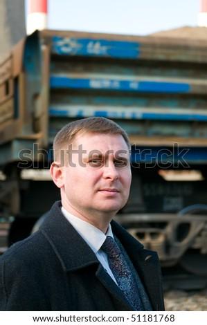 Businessman near train