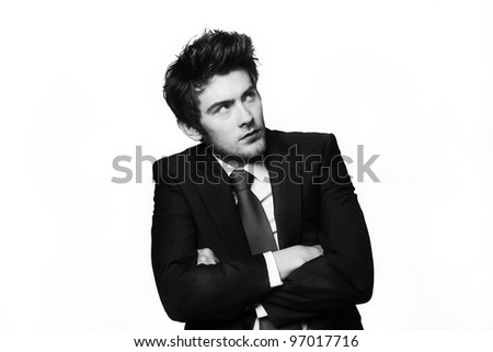 businessman not looking to happy about something looking away in the distance with his arms crossed - stock photo
