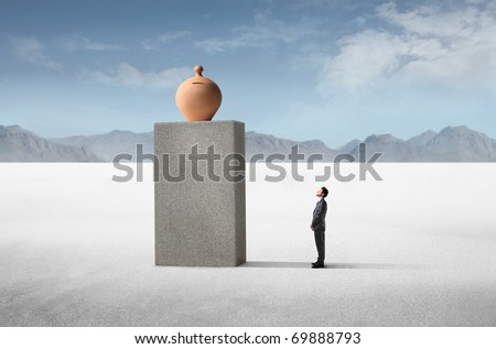 Businessman observing a money box on a high cube