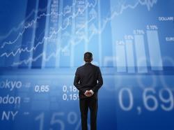 Businessman observing some statistics in front of him