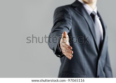 Businessman offering for handshake, close up hand