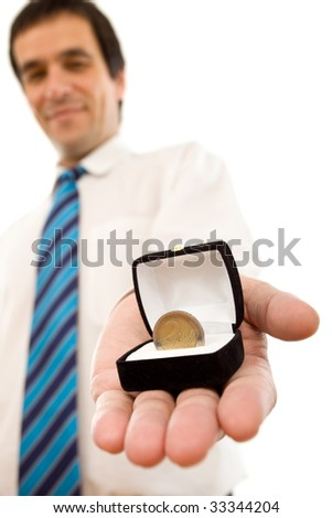 Businessman offering one euro coin in a jewel gift box - isolated success concept