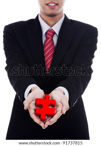 Businessman offers a puzzle with his hand