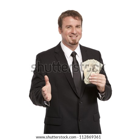 Businessman offers handshake with money