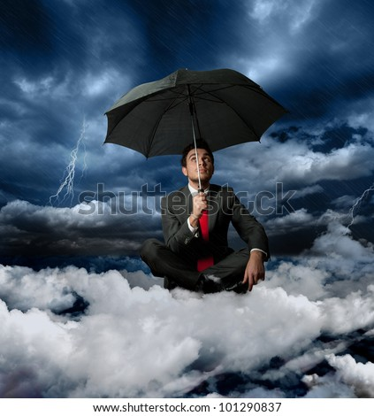 Businessman on a cloud during a storm