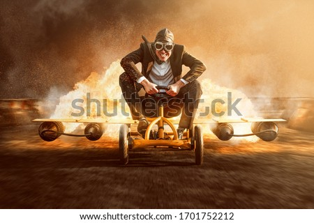 Businessman on a pedal car with a rocket engine