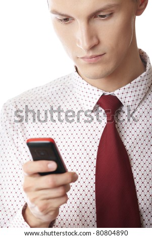 Businessman on a white background holding cellular phone and typing SMS