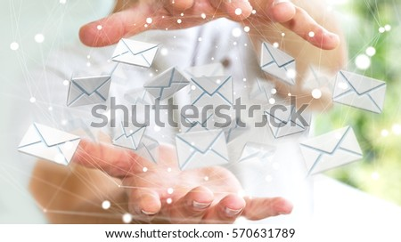 Businessman on blurred background holding 3D rendering flying email icon in his hand