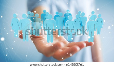 Businessman on blurred background holding 3D rendering group of people in his hand