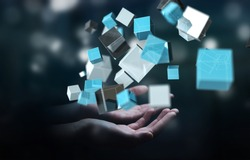 Businessman on blurred background holding floating blue shiny cube network 3D rendering