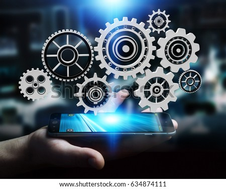 Businessman on blurred background holding floating gear icons over mobile phone 3D rendering