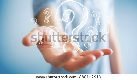 Businessman on blurred background holding hand drawn question marks #680112613