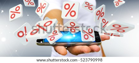 Businessman on blurred background holding sales icons over mobile phone 3D rendering