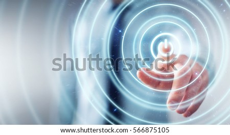 Businessman on blurred background pushing  power button with his finger