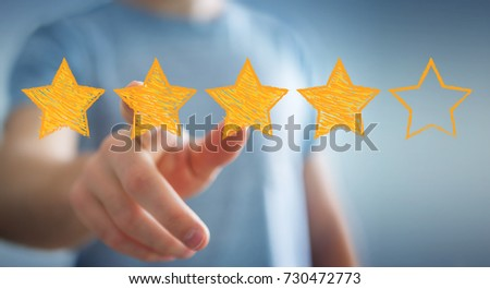Businessman on blurred background rating with hand drawn stars #730472773