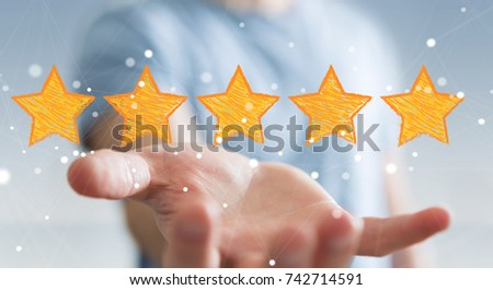 Businessman on blurred background rating with hand drawn stars #742714591
