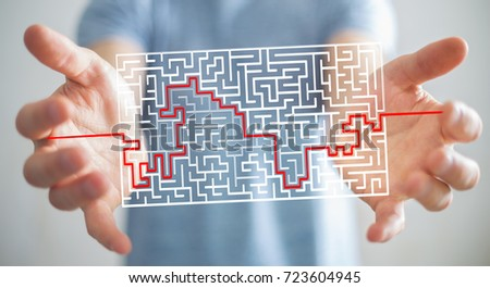 Businessman on blurred background searching solution of a complicated maze
