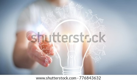 Businessman on blurred background touching renewable eco lightbulb sketch
