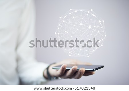 Businessman on blurred background using circle igital data network with mobile phone #517021348