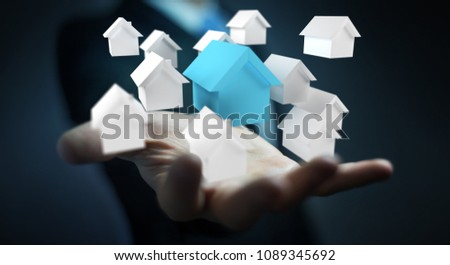 Businessman on blurred background using 3D rendered small white and blue houses #1089345692