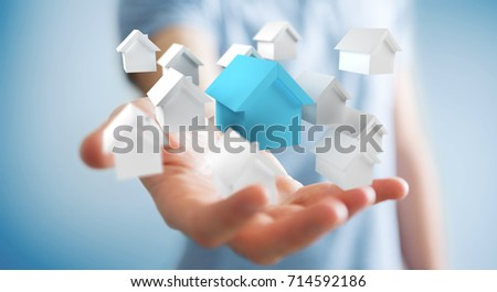 Businessman on blurred background using 3D rendered small white and blue houses #714592186