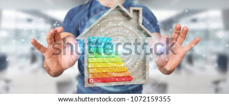 Businessman on blurred background using 3D rendering energy rating chart in a wooden house