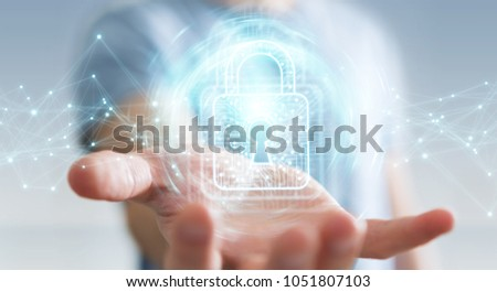 Businessman on blurred background using digital padlock with data protection 3D rendering #1051807103
