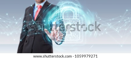 Businessman on blurred background using digital padlock with data protection 3D rendering #1059979271