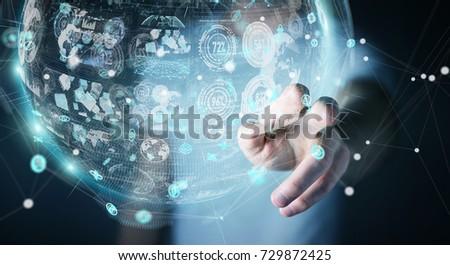 Businessman on blurred background using holograms datas digital sphere 3D rendering #729872425