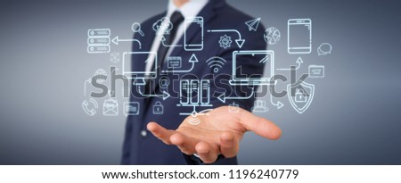 Businessman on blurred background using tech devices and icons thin line interface #1196240779