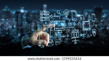 Businessman on blurred background using tech devices and icons thin line interface
