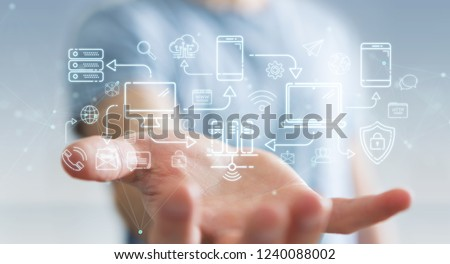 Businessman on blurred background using tech devices and icons thin line interface #1240088002
