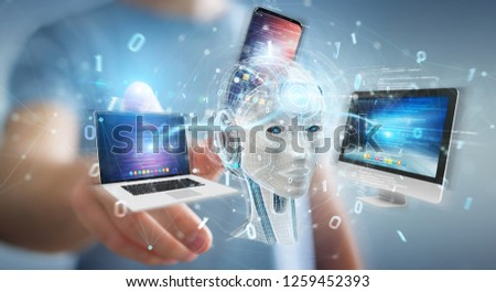 Businessman on blurred background using white humanoid controlling modern devices 3D rendering #1259452393