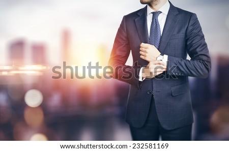 businessman on blurred city...