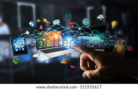 Businessman on dark background connecting tech devices 3D rendering #521933617