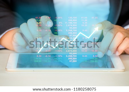 Businessman on digital stock market financial positive indicator background. Double exposure of growth graph futuristic economic currency chart investor data analysis technology money exchange concept #1180258075