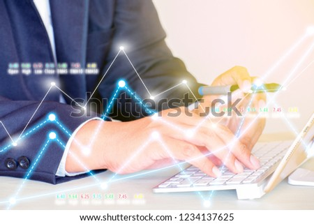 Businessman on digital stock market financial positive indicator background. Double exposure of growth graph futuristic economic currency chart investor data analysis technology money exchange concept #1234137625