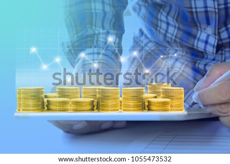 Businessman on digital stock market financial positive indicator gold coin. Double exposure of growth digital futuristic chart currency stock market financial. investor wall street crypto technology