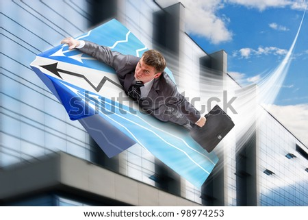 Businessman on paper airplane flying over downtown