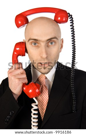 Businessman on phone juggling two calls at the same time.