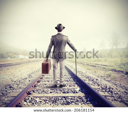 businessman on railway walking...