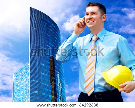 Businessman on the Modern business architecture background - stock photo