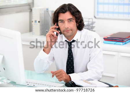 Businessman on the phone at his desk