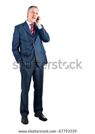 Businessman on the phone full length
