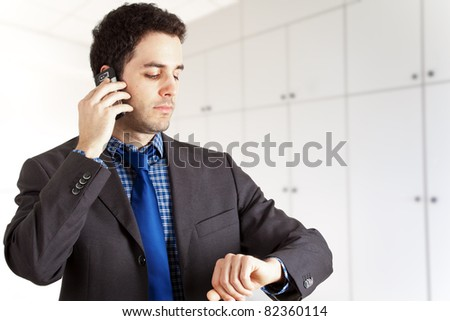 Businessman on the phone looking at his watch
