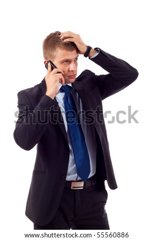 businessman on the phone with hand on his head, receiving bad news