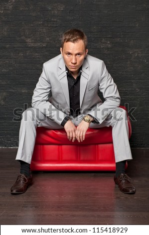 Businessman on the red chair.