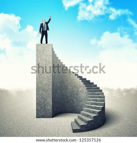 businessman on the top of concrete stair